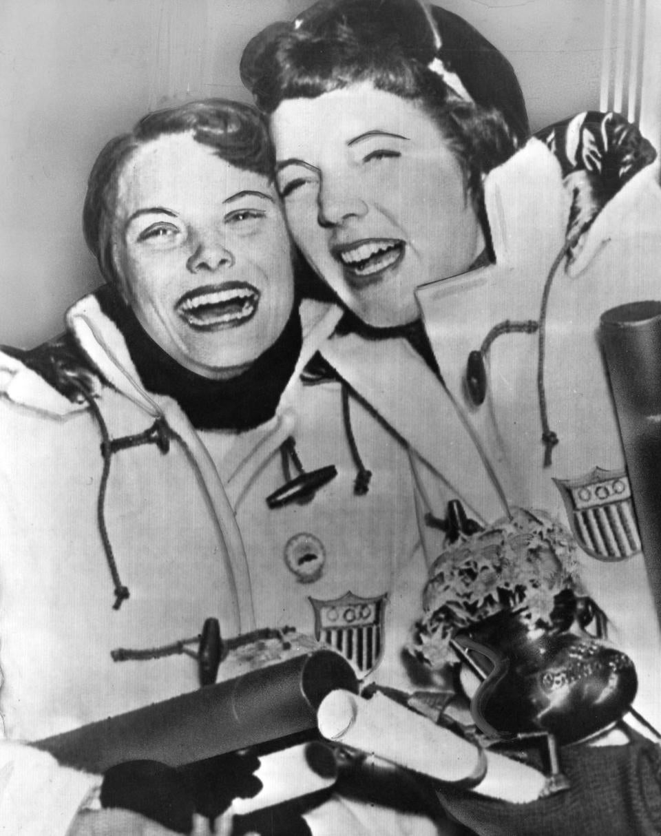 Albright and silver medalist Carol Heiss in Cortina, Italy, after receiving their medals.
